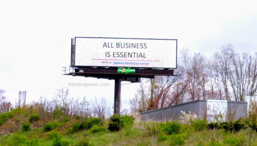 all business is essential billboard